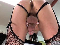 Shemale Gina Hart toying her ass while wanking her boner