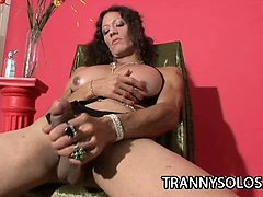 Horny shemale teasing her tits and cock