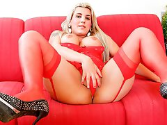 Hot shemale Morgana Smanhoto masturbates in red lingerie.